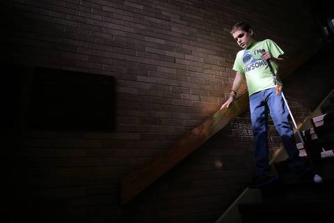 On his way to gym class, Joseph Williams navigates a stairwell at John E. Albright Middle School in Villa Park.