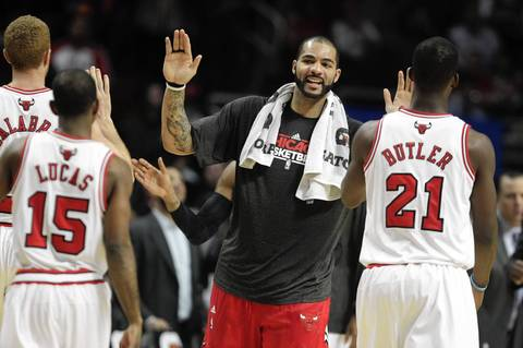 Carlos Boozer congratulates his team during a timeout in the 4th quarter against the Suns.