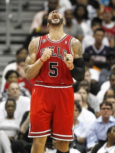 Carlos Boozer reacts after a technical foul against his team during the first half of Game 4 against Atlanta.