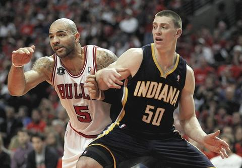 Carlos Boozer and Pacers' Tyler Hansbrough battle for position on a free throw in Game 1 at the United Center.