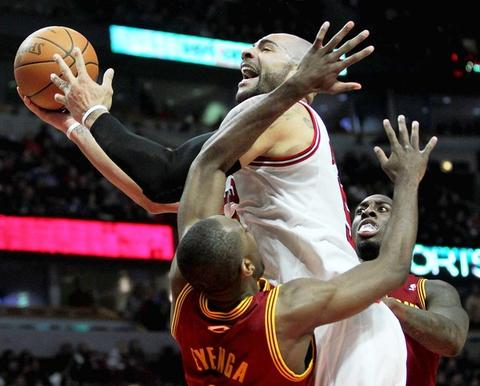 Carlos Boozer drives on Cleveland's Christian Eyenga in the second half.