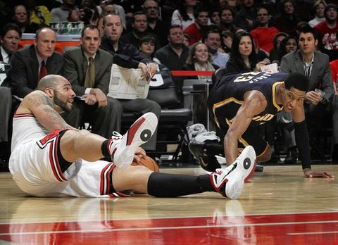 Carlos Boozer pulls a loose ball from the Pacers' Danny Granger in the 4th quarter.