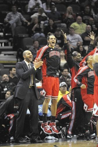 Carlos Boozer and Joakim Noah react against the Spurs.