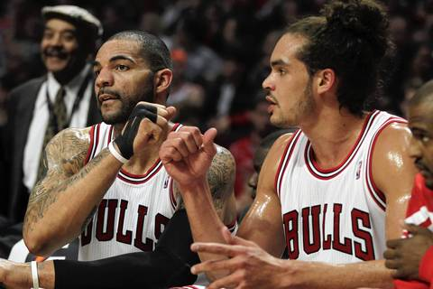 Carlos Boozer and Joakim Noah fist-bump after taking the bench in the first quarter against the Pistons.