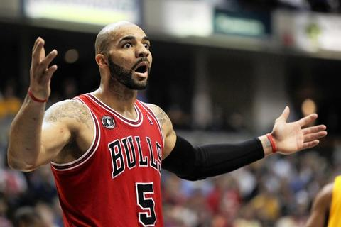 Carlos Boozer reacts after a foul was called on him in the first half against the Indiana Pacers in Game 4.