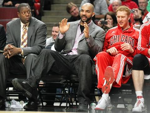 Injured Carlos Boozer reacts beside teammate Brian Scalabrine in the 4th quarter of a game against the Jazz at the United Center.