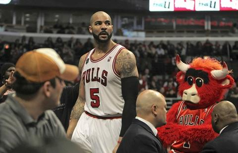 Carlos Boozer ends up in the crowd after chasing loose ball during Bulls' 85-77 win over New Orleans.