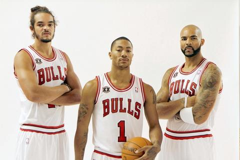 Joakim Noah, Derrick Rose and Carlos Boozer pose for a photo during media day.