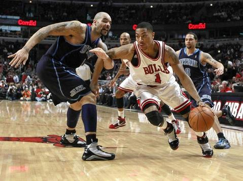 Derrick Rose drives around Utah's Carlos Boozer as he hooks him during the 2nd half at the United Center.