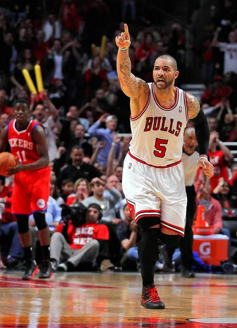 Carlos Boozer celebrates after scoring during the second half of Game 5.
