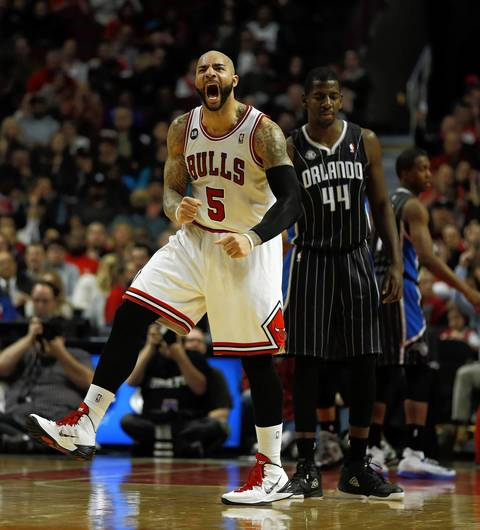 Carlos Boozer celebrates his assist against the Magic during a 108-95 win.