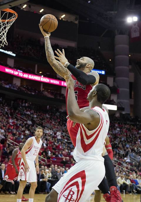 Carlos Boozer drives against the Rockets' Terrence Jones.