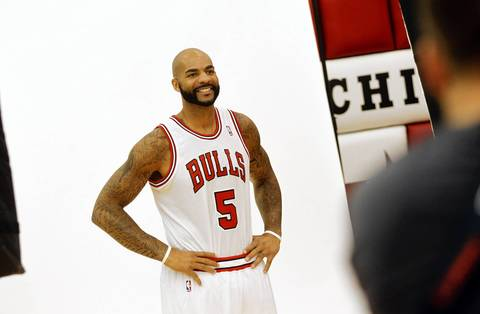 Carlos Boozer poses during the Bulls media day.