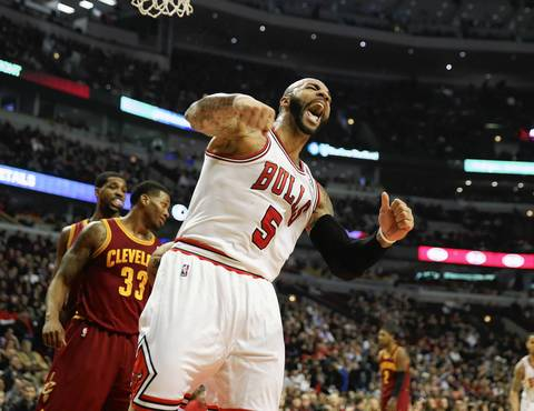 Carlos Boozer reacts after making the basket and getting the favorable call in a game against the Cavaliers.