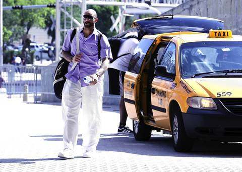 Carlos Boozer arrives at American Airlines Arena by taxi for Game 5 against the Heat.