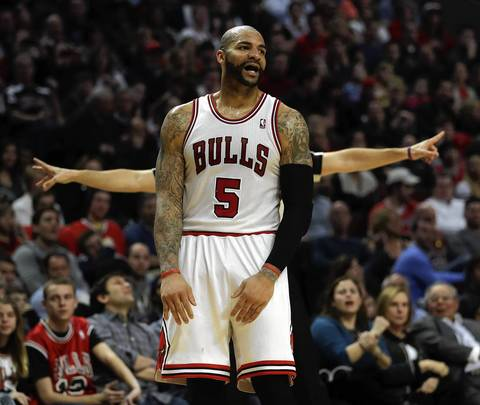 Carlos Boozer has an extra pair of arms against the Jazz at the United Center.