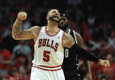 Carlos Boozer celebrates an early favorable call in front of the Nets' Reggie Evans during the first half of Game 4.