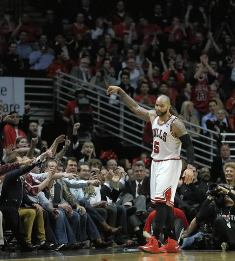 Carlos Boozer celebrates after scoring while being fouled in the second half against the Nets in Game 3 of their playoff series.