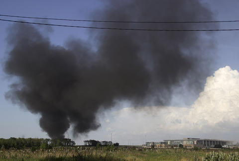 Black smoke billows from Donetsk international airport during a  heavy gun battle between the Ukrainian army and pro-Russian militants in the eastern Ukrainian city of Donetsk on May 26.