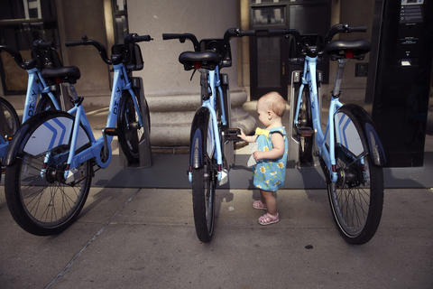 A curious Elizaveta Kaupanina, 14 months, checks out a Divvy bike station at 225 S. Canal St. on May 21, 2014.