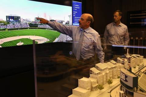 Consultant Steve Jacobsen, left, and Crane Kenney, Executive Vice President of Business Operations for the Chicago Cubs display a slide show of the newest plans for the renovation of Wrigley Field.