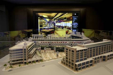 The model of Wrigley Field expansion during a slide show of the newer features.
