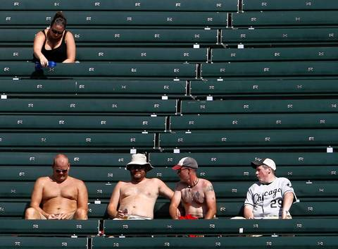 Bleacher fans try to beat the heat as the Chicago White Sox and Minnesota Twins play at U.S. Cellular Field.