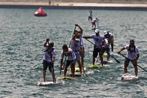 Paddle board racers compete in the long distance course at the 2012 Chicago World Paddle Challenge.