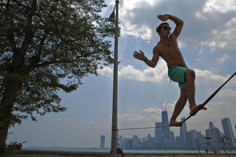 Frank Valenzano of Arlington Heights practices slacklining at North Avenue Beach.