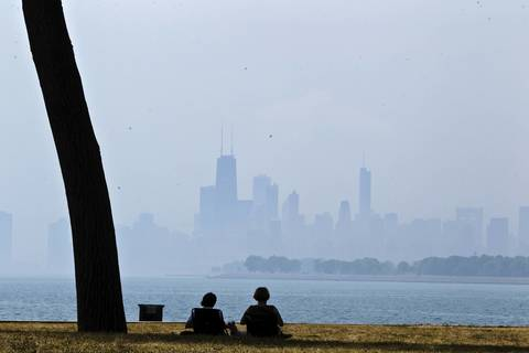 People enjoy the lake breeze at Montrose Harbor.