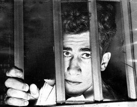 William Heirens peers out of his cell at the Cook County Jail in 1946. He pleaded guilty to killing two women in their homes and strangling Suzanne Degnan, 6, whose body was dismembered and disposed of in Chicago sewers.