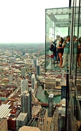 The glass boxes known as the Ledge in Chicago's former Sears Tower (now known as Willis Tower) jut out from the 103rd floor for an exhilarating view.