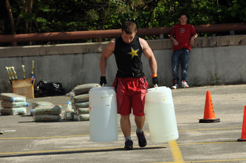 Adam Zamojski, 18, a junior at New Britain High, carries approximately 100 pounds of water in each hand during the annual Tough Man competition.