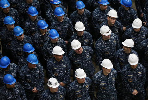 Sailors listen during a ceremony to mark the completion of the pressure hull of the submarine John Warner at Newport News Shipbuilding on April 3.