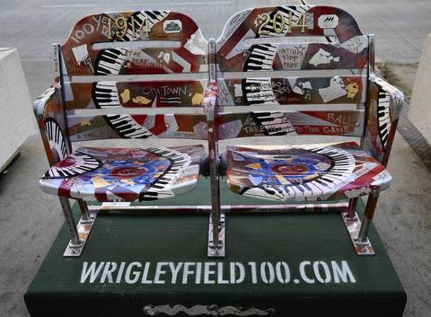 Fifty pairs of painted ballpark seats have placed on the sidewalk on Michigan Avenue to commemorate the 100th anniversary of Wrigley Field.
