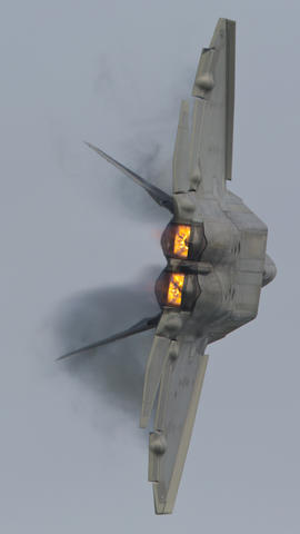 Staff Photo Of The Week: May 24-May 30, 2014   Vapor forms on the wings of an F-22 Raptor as it conducts a  high speed turn during a flight demonstration of its capabilities at Langley Air Force Base.  No Mags, No Sales, No Internet, No TV