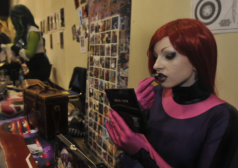 Teeny Fox of Philadelphia applies lipstick at Hartford Comic Con at the XL Center Saturday.