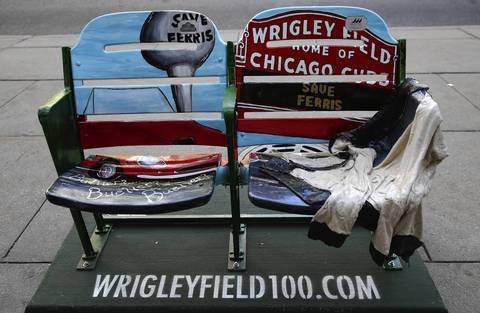 50 pairs of painted baseball stadium seats have been set up on the sidewalk along Michigan Avenue to commemorate the 100th anniversary of Wrigley Field.