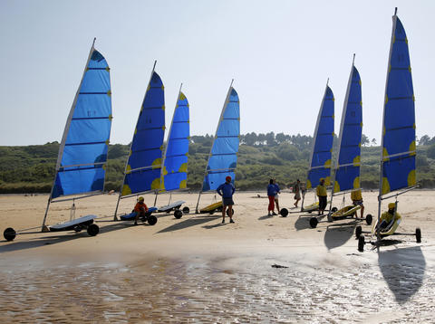 Tourists take part in a land sailing class on the former D-Day landing zone of Omaha beach near Vierville sur Mer, France August 22, 2013.