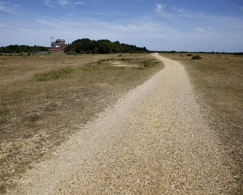 A gravel path lies on the former Royal Air Force base of Greenham Common, England, July 15, 2013. The base was used as an embarkation point for paratroops who took part in the Normandy invasion.