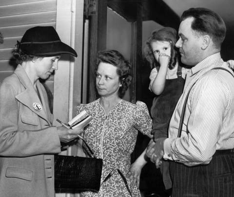 Mrs. George Hones, left, solicits a war bond purchase pledge from Eleanor Sanders, second from left, at Sanders home at 1439 Granville Avenue while her husband William and daughter Karen, 3, watch.