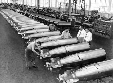 On July 5, 1943 inside the Amertorp Torpedo Ordnance Corporation's $20,000,000 factory in Forest Park, Ill., row upon row of shiny torpedoes are turned out for the Navy.