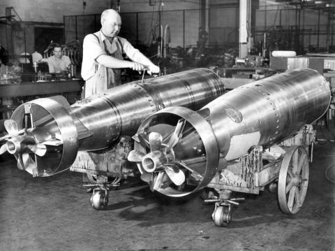 Herman J. Brandt works on the fuel and motor section of two aerial torpedoes in the Amertorp Corporation ordnance plant in Forest Park, Ill., on June 25, 1946.