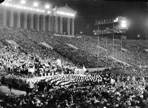 A huge crowd attends a Hollywood Bond rally in Soldier Field during Word War II.