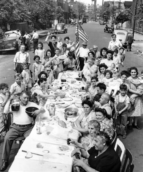 Residents of the 700 block of S. May Street celebrate victory over Japan in World War II with spaghetti, red wine, dancing and the music of tambourines.