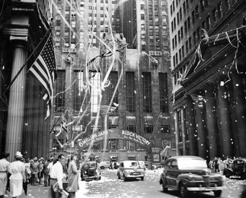 Ticker tape streams down onto LaSalle Street near Jackson Boulevard in front of the Chicago Board of Trade Building. The celebration was for V-J Day that marked victory over Japan, effectively ending World War II.