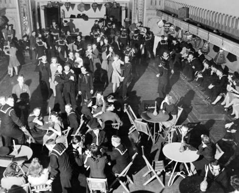 People enjoy a Saturday night in the Service Men's Center night club in 1942. As many as 26,000 men were jamming the building on weekends during World War II.