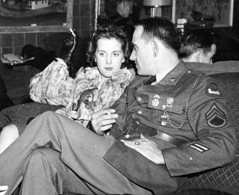 The Chicago Service Men's Center had comfortable lounges for conversation, like this one, circa Dec. 27, 1941. Women from various commercial and social groups volunteered their time at the center.