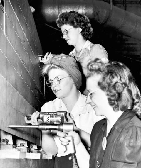"""With millions of men inducted into the armed forces during World War II, women flooded into factories to do """"men's work"""" here at home in Chicago."""