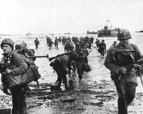 U.S. reinforcements land on Omaha beach during the Normandy D-Day landings near Vierville sur Mer, France, on June 6, 1944.